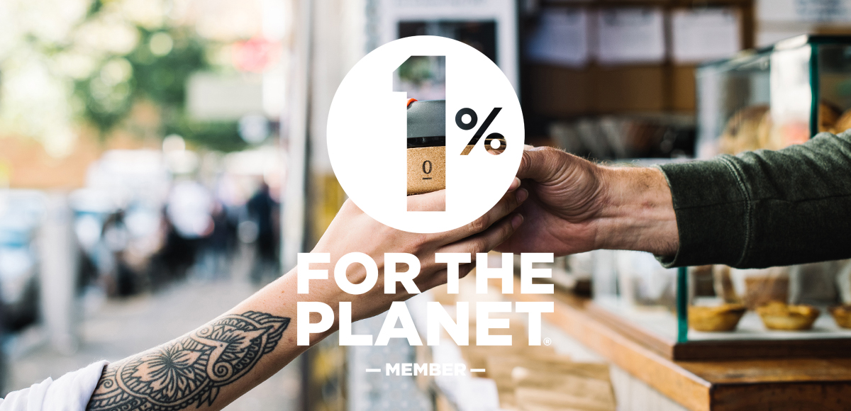 Single O Keep Cup being handed over to barista full of coffee with 1% for the Planet logo